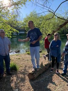 Friends gather at the river for prayer, teaching, and celebrating the baptism
